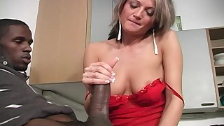 Spring Thomas sucking a black friend's cock in the kitchen before sex