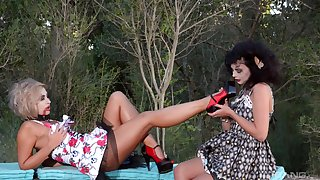 Terra and Lucy Li play lesbian sex games outside until both cum