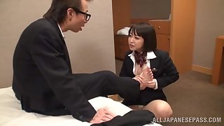 Sexy Asian couple has some divertissement in a inn room with their clothes on